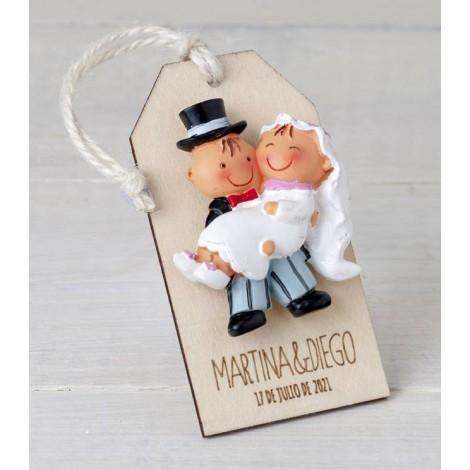 Imán Pit&Pita en brazos en colgante de madera